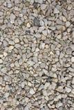 Tierra gris de la textura de la piedra y del guijarro Imagenes de archivo