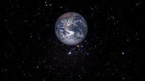 Tierra que está en órbita con las estrellas libre illustration