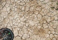 Tierra seca y un compás Foto de archivo