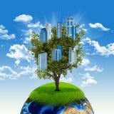 Tierra y árbol con los edificios imagenes de archivo