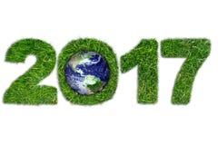Tierra y 2017 en hierba verde Imagenes de archivo