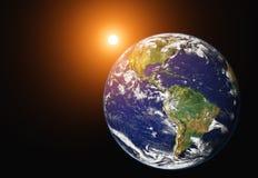 Tierra y salida del sol del planeta Fotos de archivo libres de regalías