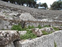 Tiers of Ancient Theater, Epidauros, Greece. Close-up of seats of ancient theater in Epidauros, Greece Royalty Free Stock Photo