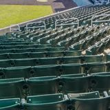 Tiers of green seats for spectators at a stadium stock photography