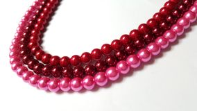 3 Tiers Maroon, Red and Pink Necklace Stock Photos