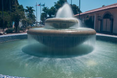 Tiers of smooth water. Silky water flowing out of the city fountain Stock Photo