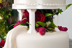 Tiers on Wedding Cake with flowers. With columns supporting top tier Royalty Free Stock Photo