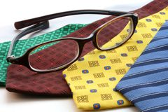 Ties. Row of ties and glasses Royalty Free Stock Images