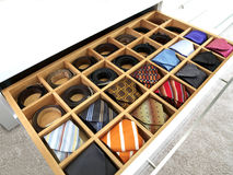 Ties and belts. In yhe wide drawer Stock Photos