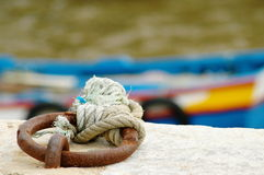 Ties. Blue wood fishing boat moored Royalty Free Stock Photography