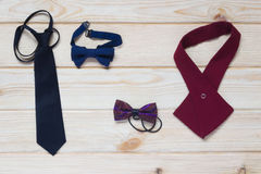 Ties for children on the table. Baby ties and butterflies on the table Stock Image