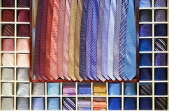 Ties collection on the shelf of a shop Stock Photos