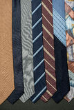 Ties of different colors. Several different colors ties hanging on black background Royalty Free Stock Photos