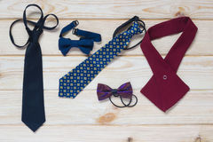 Ties for school children on the table. Ties and butterflies on the table for school children Royalty Free Stock Photography