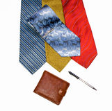 Ties are varicoloured, purse and pen. On a white background Stock Photography