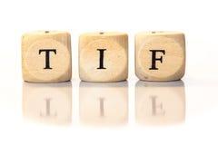 TIF deletreó la palabra, letras de los dados con la reflexión Imágenes de archivo libres de regalías