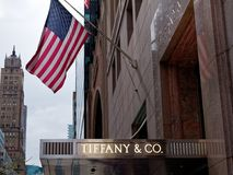 Tiffany & Co Sign shop and USA or American Flag in Manhattan. New York City, Usa - Apr 2018: Tiffany & Co Sign shop and USA or American Flag in Manhattan Royalty Free Stock Photography