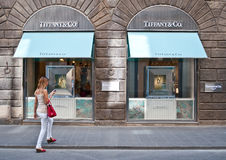 Tiffany & co. store Florence ,Italy. Girl in the front of store Tiffany & Company is an American multinational luxury jewelry and specialty retailer, having Stock Image