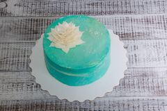 Tiffany cream cheese cake with chocolate flower. A tiffany cream cheese cake with chocolate flower royalty free stock photos