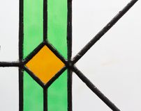 Tiffany glass processing. Artistic processing of a Tiffany stained glass window with seal stock photos