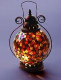 Tiffany lamp. Tiffany Glass Table Lamp on dark blue background Stock Photo