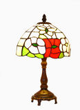 Tiffany lamp. An tiffany lamp with wood stand on white background stock photography