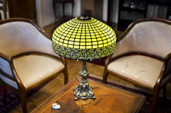 Tiffany lamp. On wooden table stock image