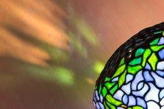 Tiffany style lamp and reflections. Diagonal close up. Royalty Free Stock Photos