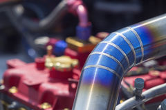 Tig welded stainless steel pipe in racing car. Tig welded stainless steel turbocharger pipe in racing car royalty free stock photography