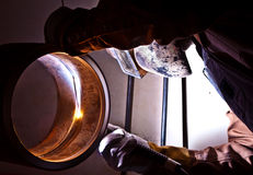 TIG welding. A craftsman tig welding pipe Royalty Free Stock Images