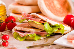 Tigella bread stuffed with ham and lettuce. Stock Photos
