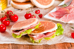 Tigella bread stuffed with ham and lettuce. Stock Images