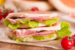 Tigella bread stuffed with ham and lettuce. Stock Image