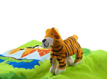 Tiger. Soft toy tiger in the grass  isolated on a white background close up Stock Images