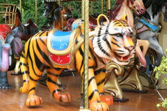 Tiger. Childrens carousel with parade of animals stock photography