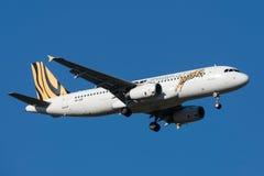 Tiger Airways Airbus A320-232 VH-VNF na aproximação à terra no aeroporto internacional de Melbourne Fotografia de Stock Royalty Free
