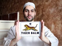 Tiger Balm brand logo. Logo of Tiger Balm brand on samsung tablet holded by arab muslim man. Tiger Balm is the trademark for a heat rub manufactured and Royalty Free Stock Image