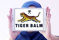 Tiger Balm brand logo. Logo of Tiger Balm brand on samsung tablet holded by arab muslim woman. Tiger Balm is the trademark for a heat rub manufactured and Royalty Free Stock Photos