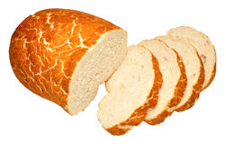 Tiger Bread Bloomer Loaf. Crusty tiger bread bloomer loaf partially sliced, isolated on a white background Royalty Free Stock Images