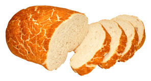Tiger Bread Bloomer Loaf. Crusty tiger bread bloomer loaf partially sliced, isolated on a white background Stock Image