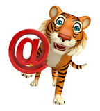 Tiger cartoon character with at the rate Stock Photos