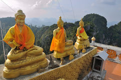 Tiger Cave Temple in Thailand, Krabi. Golden Buddha statues, located high above the mountain, after steep climb of 1237 Royalty Free Stock Photos