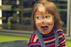 Tiger. Children's face body - art. Figure tiger Royalty Free Stock Images