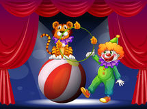 A tiger and a clown performing at the stage Stock Photo