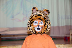 Tiger costume for school performance. mask for child.Children face painting. Boy  painted as tiger or ferocious lion. Boy actor Royalty Free Stock Image