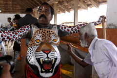 Tiger dance procession. A trained artist gets his body painted like tiger, to participate in the Pulikkali or Tiger dance procession, in Thrissur, Kerala, India Stock Images
