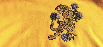 Tiger embroidery on a yellow sweatshirt. Tiger embroidery on a sweatshirt royalty free stock image