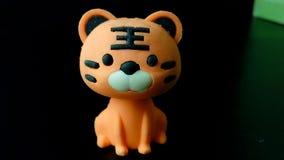 Tiger eraser doll. Tiger eraser on black background Royalty Free Stock Photography