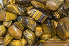 Free Tiger Eye Stones Ready To Make Handmade Jewelry. Tiger`s Eye And Hawk`s Eye Gemstone As Natural Mineral Rock Specimen Royalty Free Stock Images - 146703809