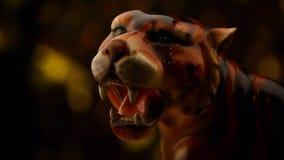 Tiger figure gold bokeh. Studio stock footage